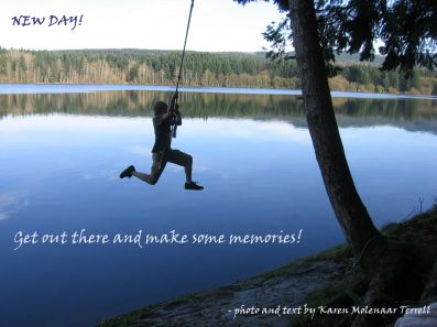 Sons swinging over Lake Padden.