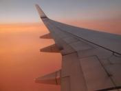 Plane's wing in sunset - photo by Karen Molenaar Terrell
