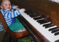 little Drew playing piano