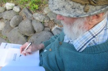 Dad authographing book