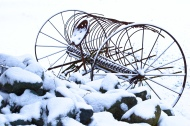 old farm equipment in the snow this one